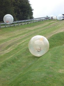 People Zorbing by Anna Caswell